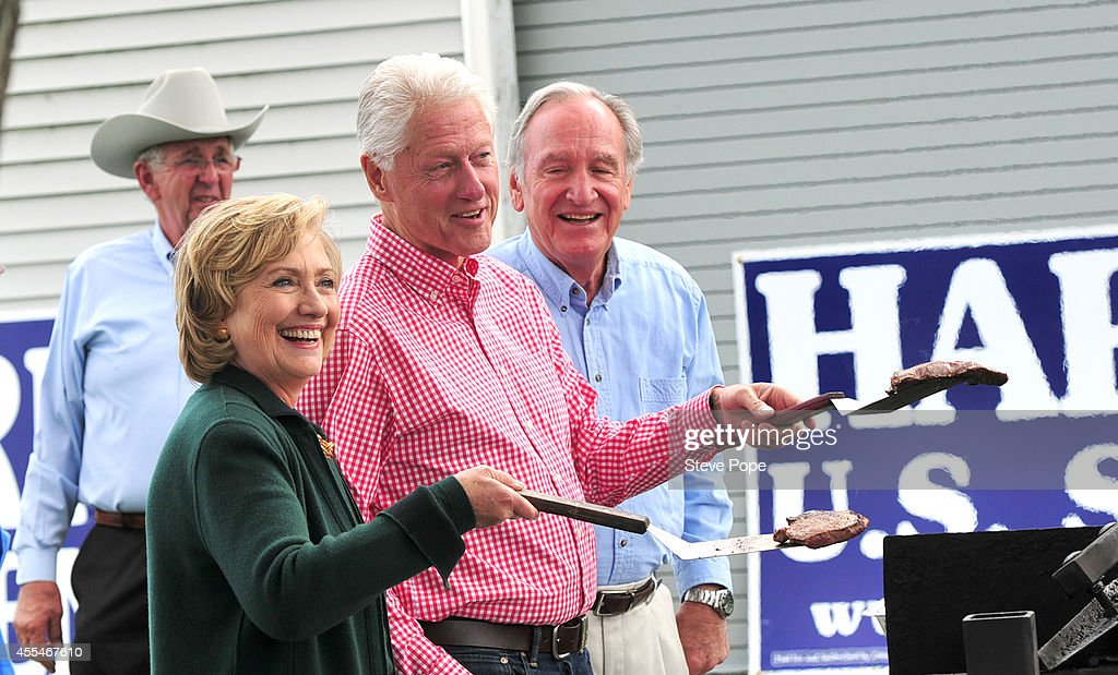 Former US President Bill Clinton and his wife former Secretary of State Hillary Rodham Clinton and US Senator Tom Harkin flip steaks at the 37th...