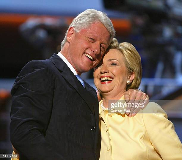 Former US President Bill Clinton and his wife US Senator Hillary Clinton take the stage on the first day of the Democratic National Convention July...