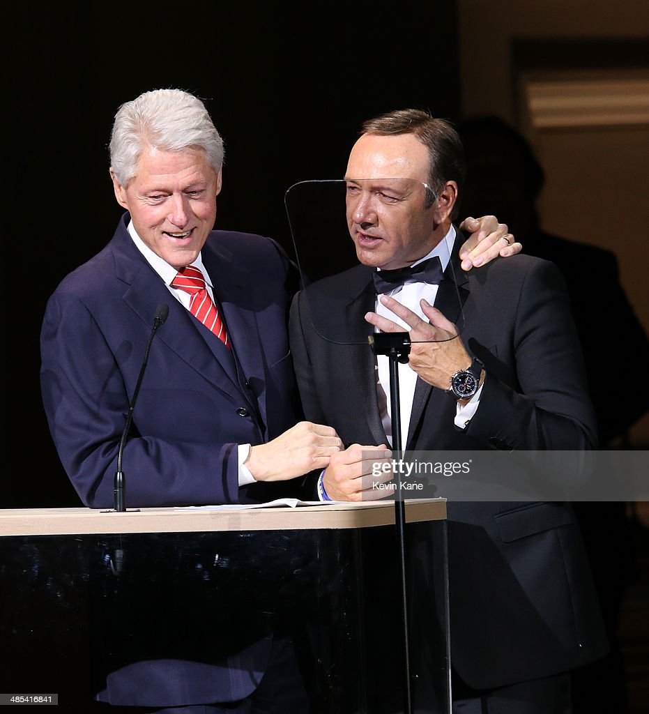 Former US President Bill Clinton and Kevin Spacey speak on stage at The 2014 Revlon Concert For The Rainforest Fund at Carnegie Hall on April 17, 2014 in New York City.