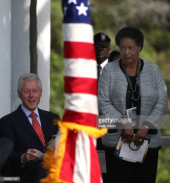 Former US President Bill Clinton and Myrlie Evers participate in a ceremony to honor civil rights pioneer Medgar Evers at an Arlington National...