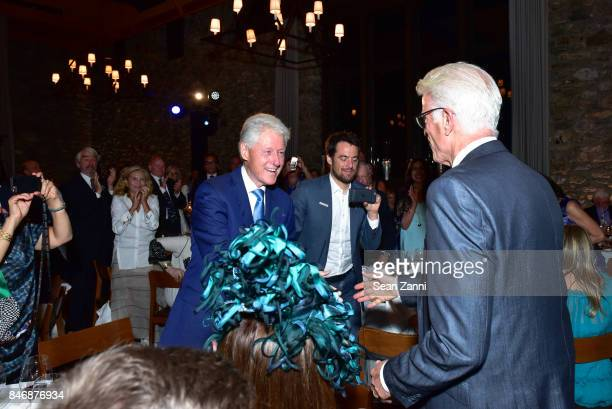 Former US President Bill Clinton and Ted Danson attend the Oceana New York Gala at Blue Hill at Stone Barns on September 13 2017 in Tarrytown New York