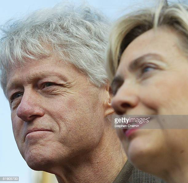 Former US President Bill Clinton and US Senator Hillary Rodham Clinton stand during a visit to the New York Buddhist Vihara December 31 2004 in the...