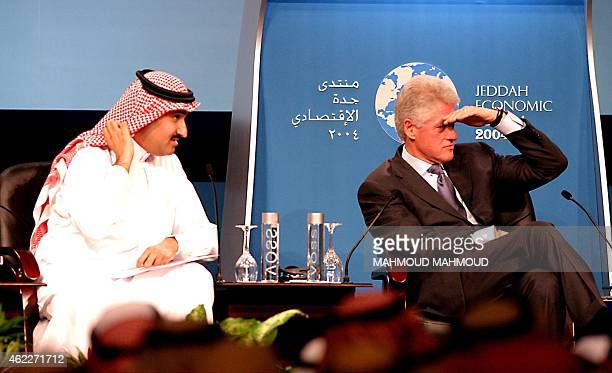 Former US President Bill Clinton answers the attendants questions next to Saudi Prince Faysal bin Salman CEO of Saudi Research and Marketing Company...