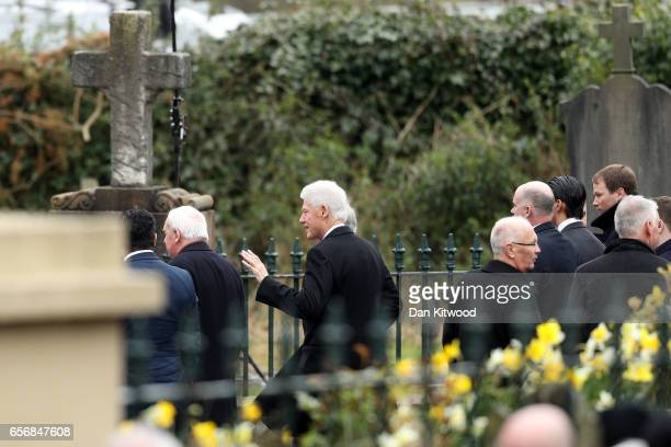 Former US president Bill Clinton arrives at St Columba's Church on March 23 2017 in Londonderry Northern Ireland The funeral is held for Northern...