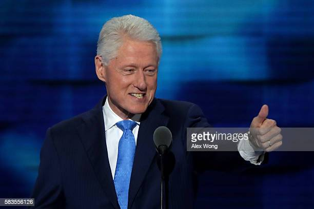 Former US President Bill Clinton arrives on stage to deliver remarks on the second day of the Democratic National Convention at the Wells Fargo...