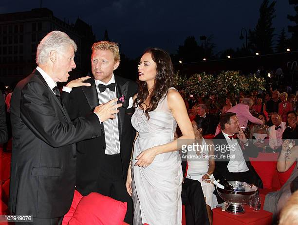 Former US President Bill Clinton Boris Becker and wife Lilly attend the 18th Life Ball at the Town Hall on July 17 2010 in Vienna Austria The Life...
