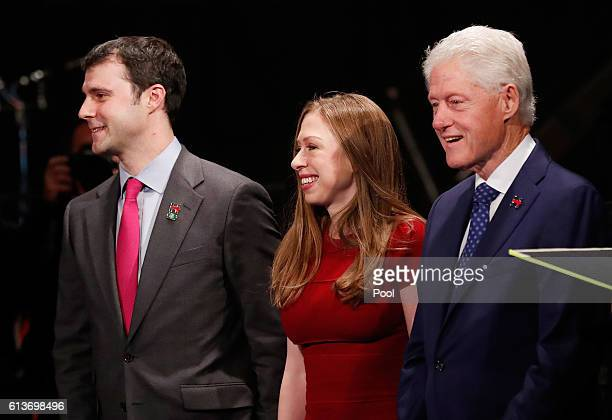Former US President Bill Clinton daughter Chelsea Clinton and Marc Mezvinsky arrive before the town hall debate at Washington University on October 9...