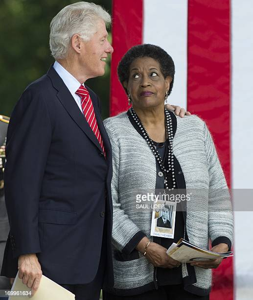 Former US President Bill Clinton embraces Myrlie EversWilliams wife of the late civil rights activist Medgar Evers during a wreath laying ceremony...