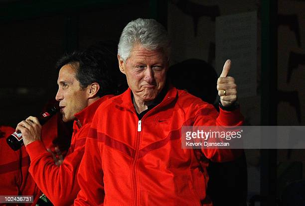 Former US President Bill Clinton enjoys the atmosphere prior to the 2010 FIFA World Cup South Africa Round of Sixteen match between USA and Ghana at...