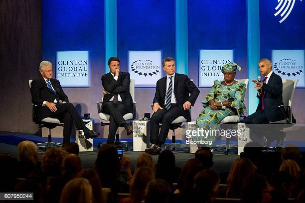 Former US President Bill Clinton from left Matteo Renzi prime minister of Italy Mauricio Macri president of Argentina Ngozi OkonjoIweala former chair...