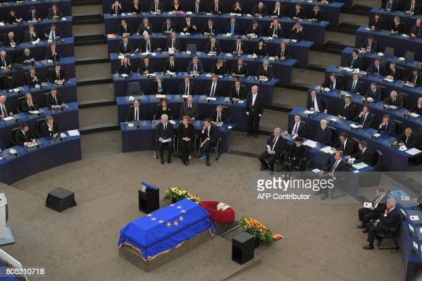 Former US President Bill Clinton German Chancellor Angela Merkel French President Emmanuel Macron European Commission President JeanClaude Juncker...