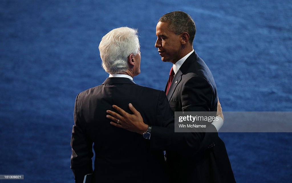 Former U.S. President <a gi-track='captionPersonalityLinkClicked' href=/galleries/search?phrase=Bill+Clinton&family=editorial&specificpeople=67203 ng-click='$event.stopPropagation()'>Bill Clinton</a> greets Democratic presidential candidate, U.S. President <a gi-track='captionPersonalityLinkClicked' href=/galleries/search?phrase=Barack+Obama&family=editorial&specificpeople=203260 ng-click='$event.stopPropagation()'>Barack Obama</a> (L) on stage during day two of the Democratic National Convention at Time Warner Cable Arena on September 5, 2012 in Charlotte, North Carolina. The DNC that will run through September 7, will nominate U.S. President <a gi-track='captionPersonalityLinkClicked' href=/galleries/search?phrase=Barack+Obama&family=editorial&specificpeople=203260 ng-click='$event.stopPropagation()'>Barack Obama</a> as the Democratic presidential candidate.