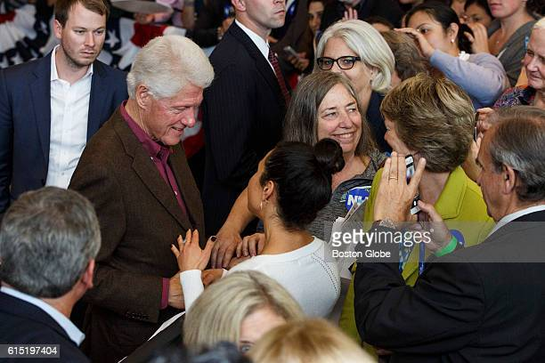 Former US President Bill Clinton greets guests after speaking on behalf of his wife Democratic presidential nominee Hillary Clinton during a campaign...