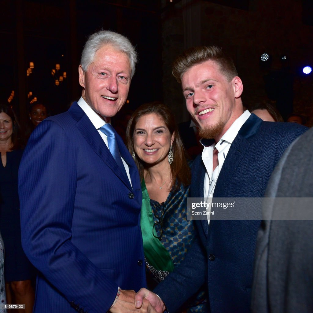 Former U.S. President Bill Clinton, Guest and Guest attend the Oceana New York Gala at Blue Hill at Stone Barns on September 13, 2017 in Tarrytown, New York.