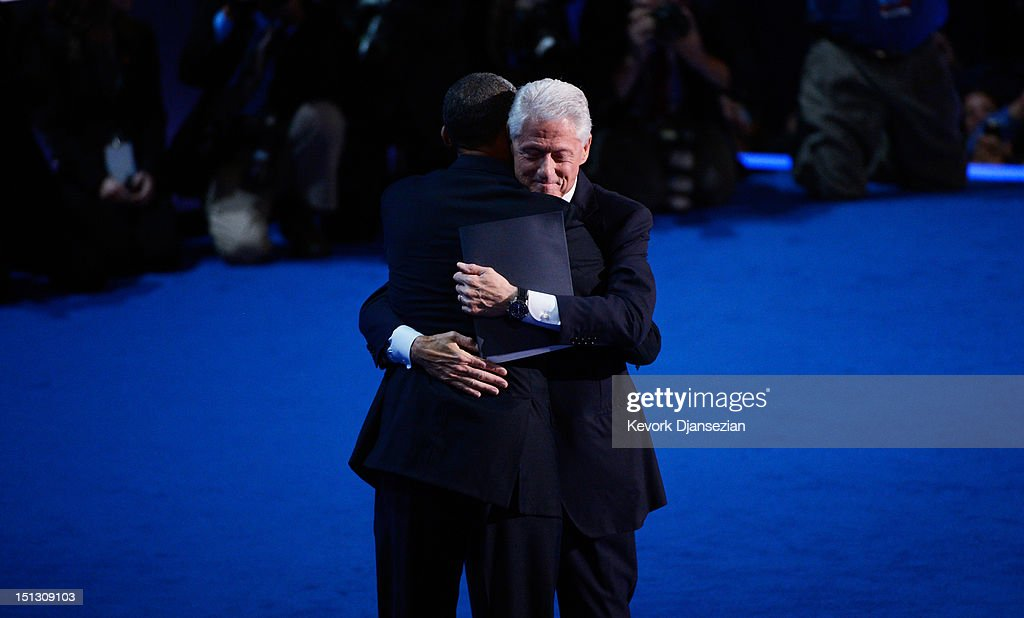 Former U.S. President <a gi-track='captionPersonalityLinkClicked' href=/galleries/search?phrase=Bill+Clinton&family=editorial&specificpeople=67203 ng-click='$event.stopPropagation()'>Bill Clinton</a> hugs Democratic presidential candidate, U.S. President <a gi-track='captionPersonalityLinkClicked' href=/galleries/search?phrase=Barack+Obama&family=editorial&specificpeople=203260 ng-click='$event.stopPropagation()'>Barack Obama</a> (L) on stage during day two of the Democratic National Convention at Time Warner Cable Arena on September 5, 2012 in Charlotte, North Carolina. The DNC that will run through September 7, will nominate U.S. President <a gi-track='captionPersonalityLinkClicked' href=/galleries/search?phrase=Barack+Obama&family=editorial&specificpeople=203260 ng-click='$event.stopPropagation()'>Barack Obama</a> as the Democratic presidential candidate.