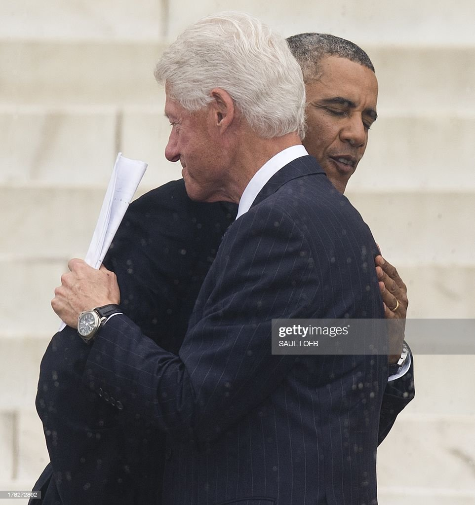 Former US President Bill Clinton hugs US President Barack Obama after speaking during the Let Freedom Ring Commemoration and Call to Action to commemorate the 50th anniversary of the March on Washington for Jobs and Freedom at the Lincoln Memorial in Washington, DC on August 28, 2013. Thousands gathered on the mall on the anniversary of the march and Dr. Martin Luther King, Jr.'s famous 'I Have a Dream' speech. AFP PHOTO / Saul LOEB