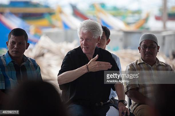 Former US president Bill Clinton interview with Aceh villagers on tsunami during a visit in Banda Aceh in Aceh province Indonesia on July 19 2014...