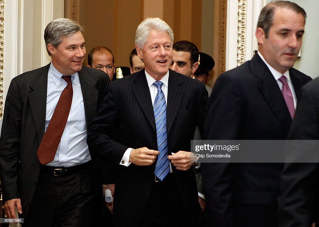 Former U.S. President <a gi-track='captionPersonalityLinkClicked' href=/galleries/search?phrase=Bill+Clinton&family=editorial&specificpeople=67203 ng-click='$event.stopPropagation()'>Bill Clinton</a> is accompanied by Sen. <a gi-track='captionPersonalityLinkClicked' href=/galleries/search?phrase=Sheldon+Whitehouse&family=editorial&specificpeople=599442 ng-click='$event.stopPropagation()'>Sheldon Whitehouse</a> (D-RI) (L) as he heads into the Senate Democratic Caucus luncheon at the U.S. Capitol November 10, 2009 in Washington, DC. Clinton was on the Hill to talk to lawmakers about passing health care reform legislation through the Senate.