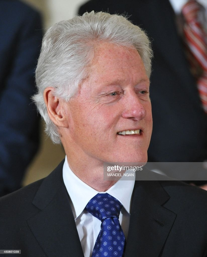 Former US President Bill Clinton is seen during the Presidential Medal of Freedom ceremony at the White House on November 20, 2013 in Washington, DC. The Medal of Freedom is the country's highest civilian honor. AFP PHOTO/Mandel NGAN