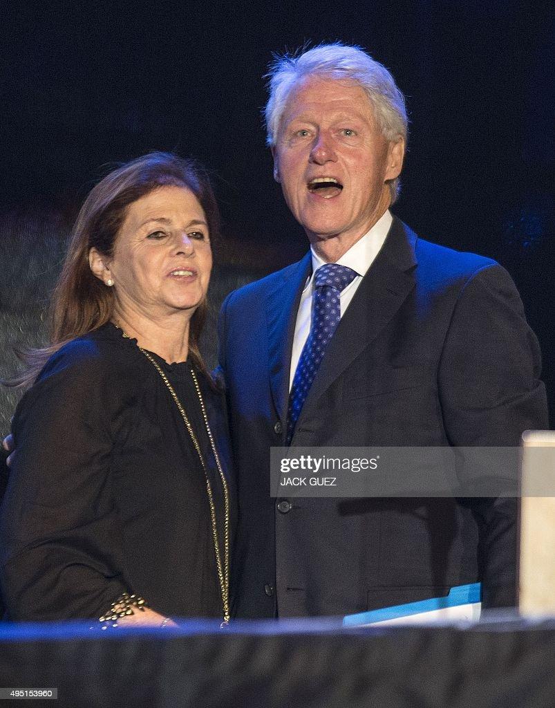 Former US president Bill Clinton (R) is welcomed by <a gi-track='captionPersonalityLinkClicked' href=/galleries/search?phrase=Dalia+Rabin-Pelossof&family=editorial&specificpeople=2575928 ng-click='$event.stopPropagation()'>Dalia Rabin-Pelossof</a>, daughter of late Israeli prime minister Yitzhak Rabin, ahead of his speech during a commemorative rally in memory of late Israeli prime minister Yitzhak Rabin, at Rabin Square in the Israeli coastal city of Tel Aviv on October 31, 2015. The rally is part of commemorations marking the 20th anniversary of Rabin's killing by a right-wing Jewish extremist. AFP PHOTO / JACK GUEZ