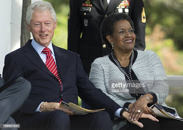 Former US President Bill Clinton joins Myrlie EversWilliams wife of the late civil rights activist Medgar Evers during a wreath laying ceremony and...