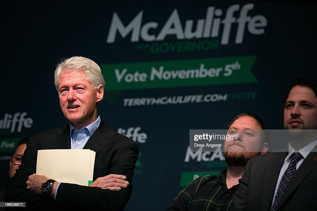 Former U.S. President Bill Clinton, L, listens to Virginia gubernatorial candidate Terry McAuliffe (D) during a campaign event for McAuliffe at VFW Post 1503, October 27, 2013 in Dale City, Virginia. McAuliffe is in a closely contested race with Republican candidate Ken Cuccinelli.
