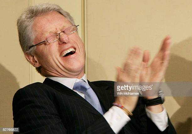 Former US President Bill Clinton laughs during his introduction at the American Jewish Committee's annual meeting May 6 2005 in Washington DC The...