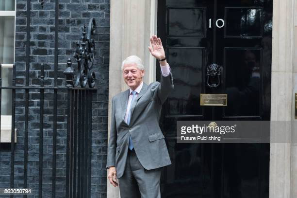 Former US President Bill Clinton leaves 10 Downing Street in central London following talks with British Prime Minister Theresa May on political...