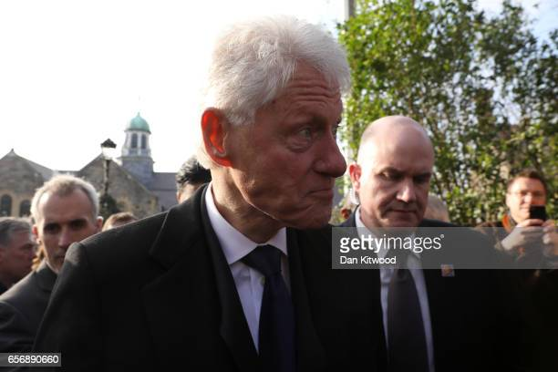 Former US president Bill Clinton leaves St Columba's Church after th funeral service for Martin McGuinness on March 23 2017 in Londonderry Northern...
