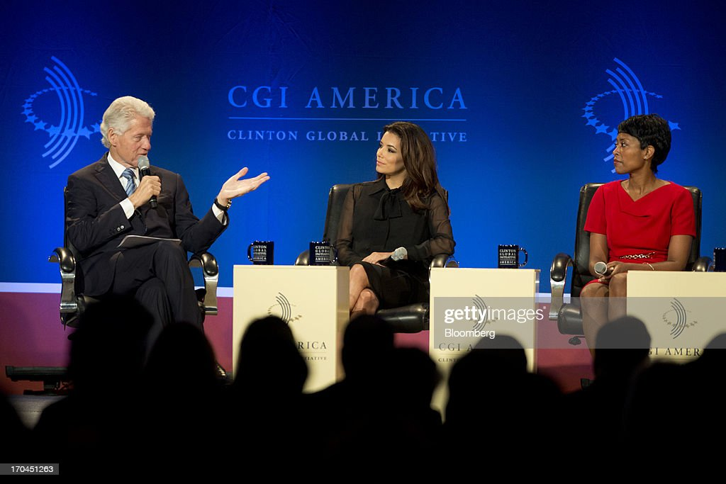 Former U.S. President Bill Clinton, left, speaks during a panel discussion as Eva Longoria, actress and founder of The Eva Longoria Foundation, center, and Laysha Ward, president of community relations for Target Corp., during the Clinton Global Initiative CGI America meeting in Chicago, Illinois, U.S., on Thursday, June 13, 2013. New Jersey governor Chris Christie and Democrat Hillary Clinton, both potential presidential candidates will be able to use the forum to test policy messages in front of an audience of U.S. mayors and other civic and business leaders. Photographer: Daniel Acker/Bloomberg via Getty Images