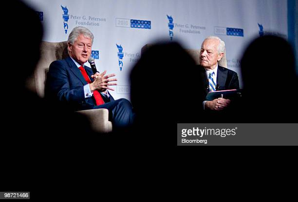 Former US President Bill Clinton left speaks to CBS news anchor Bob Schieffer during the Peter G Peterson Foundation fiscal summit in Washington DC...