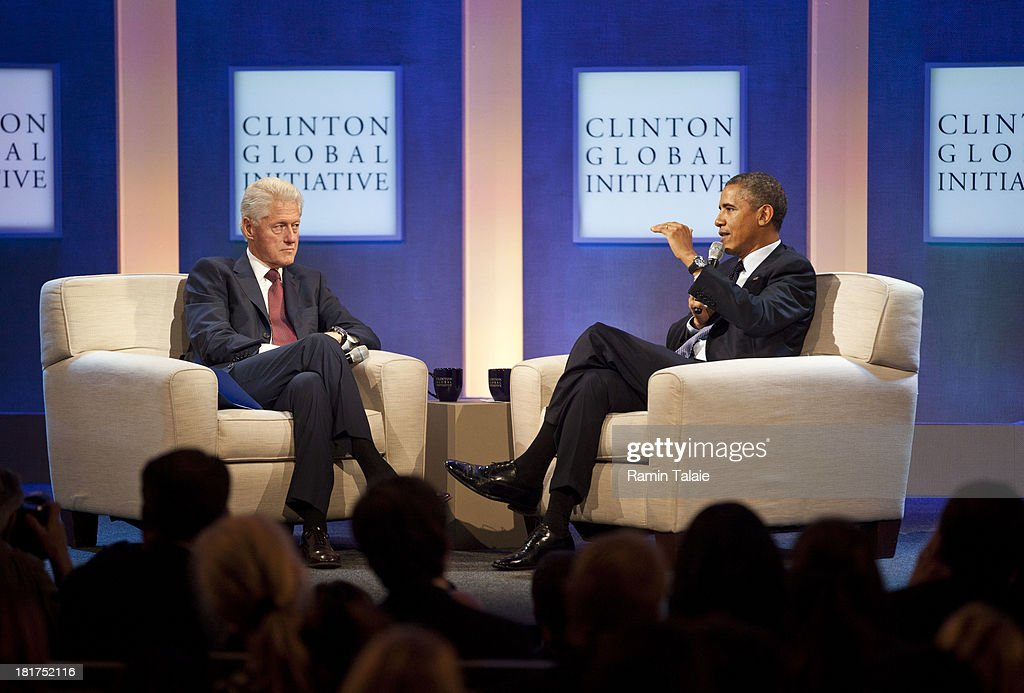 Former U.S. President <a gi-track='captionPersonalityLinkClicked' href=/galleries/search?phrase=Bill+Clinton&family=editorial&specificpeople=67203 ng-click='$event.stopPropagation()'>Bill Clinton</a> (L) listens to U.S. President <a gi-track='captionPersonalityLinkClicked' href=/galleries/search?phrase=Barack+Obama&family=editorial&specificpeople=203260 ng-click='$event.stopPropagation()'>Barack Obama</a> during the annual Clinton Global Initiative (CGI) meeting on September 24, 2013 in New York City. Timed to coincide with the United Nations General Assembly, CGI brings together heads of state, CEOs, philanthropists and others to help find solutions to the world's major problems.