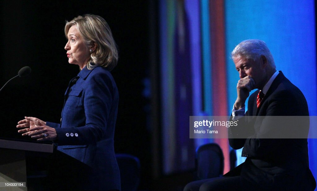 Former U.S. President <a gi-track='captionPersonalityLinkClicked' href=/galleries/search?phrase=Bill+Clinton&family=editorial&specificpeople=67203 ng-click='$event.stopPropagation()'>Bill Clinton</a> (R) looks on as U.S. Secretary of State Hillary Rodham Clinton speaks during the annual Clinton Global Initiative (CGI) September 21, 2010 in New York City. The sixth annual meeting of the CGI gathers prominent individuals in politics, business, science, academics, religion and entertainment to discuss global issues such as climate change and the reconstruction of Haiti. The event, founded by Clinton after he left office, is held the same week as the General Assembly at the United Nations, when most world leaders are in New York City.