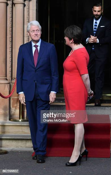 Former US President Bill Clinton looks skywards as he stands with DUP leader Arlene Foster at the Culloden Hotel following a private meeting on...