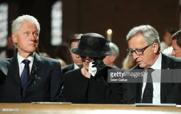Former US President Bill Clinton Maike KohlRichter the widow of Helmut Kohl and European Commission President JeanClaude Juncker attend a requiem for...