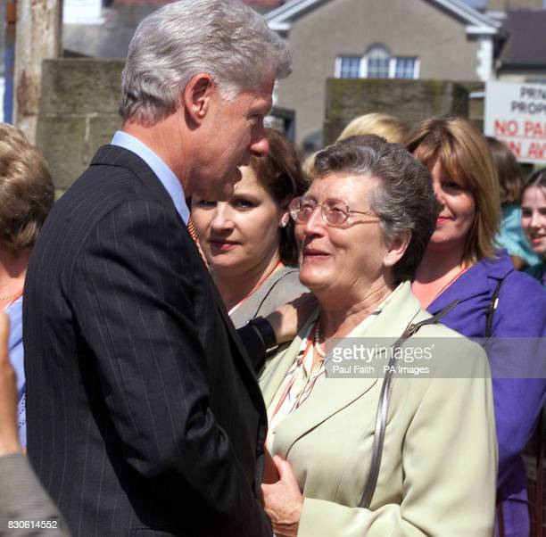 Former US President Bill Clinton meets Joan Wilson wife of former Senator Gordon Wilson and mother of Marie Wilson a victim of the Poppy Day bombing...