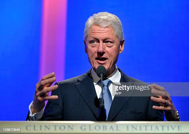 Former US President Bill Clinton opens the proceedings of the 2011 Clinton Global Initiative meeting on September 20 2011 in New York Attending the...