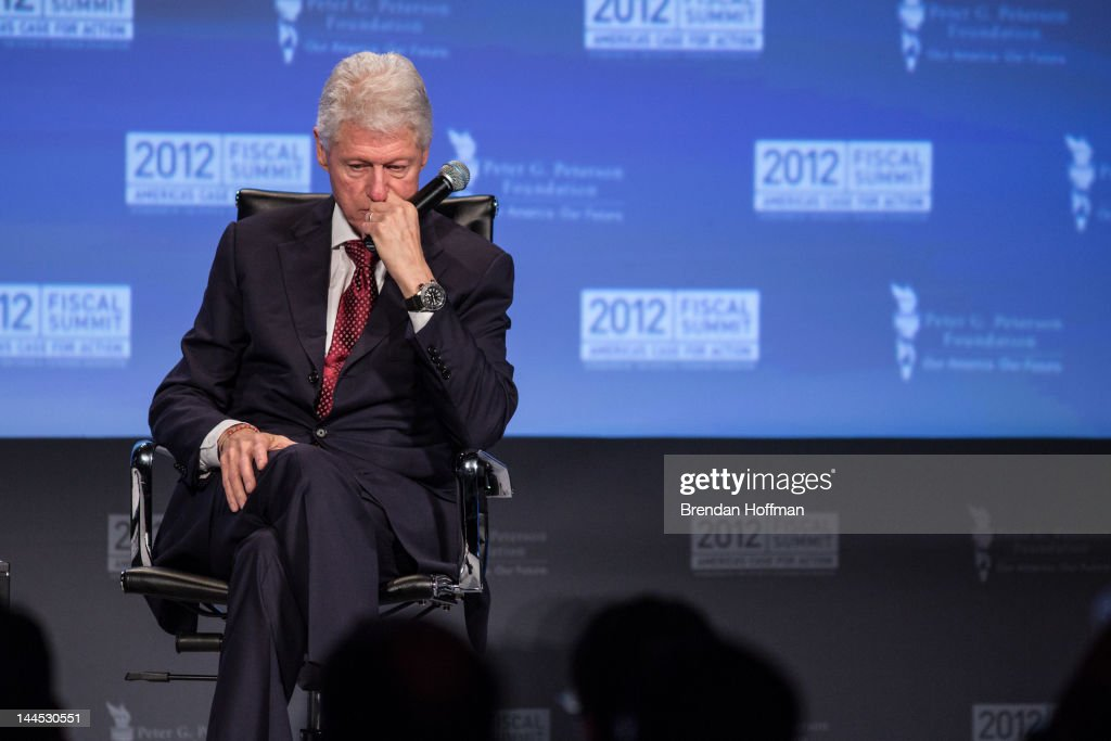 Former U.S. President <a gi-track='captionPersonalityLinkClicked' href=/galleries/search?phrase=Bill+Clinton&family=editorial&specificpeople=67203 ng-click='$event.stopPropagation()'>Bill Clinton</a> pauses at the 2012 Fiscal Summit on May 15, 2012 in Washington, DC. The third annual summit, held by the Peter G. Peterson Foundation, explored the theme 'America's Case for Action.'