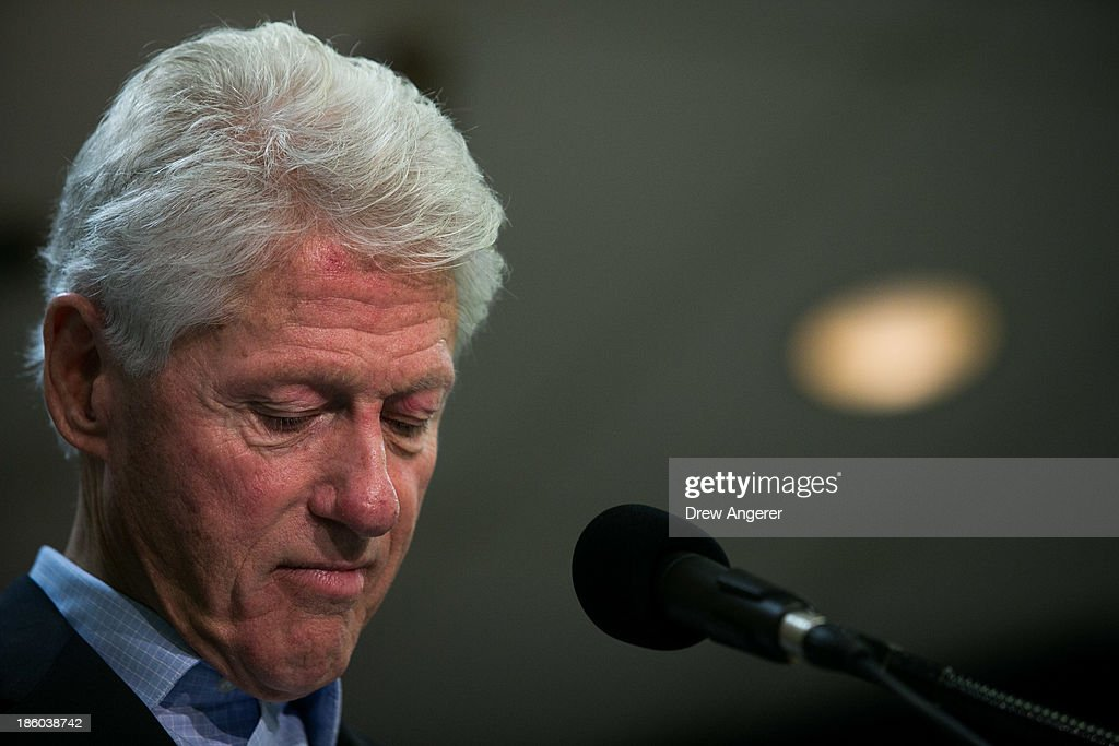 Former U.S. President Bill Clinton pauses while speaking during during a campaign event for Virginia gubernatorial candidate Terry McAuliffe at VFW Post 1503, October 27, 2013 in Dale City, Virginia. McAuliffe is in a closely contested race with Republican candidate Ken Cuccinelli.