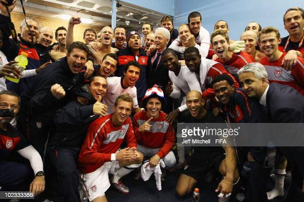 Former US President Bill Clinton poses with jubilant US players in their dressing room after the 2010 FIFA World Cup South Africa Group C match...