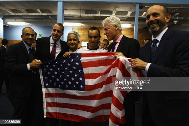 Former US President Bill Clinton poses with Landon Donovan US Major League Soccer Commissioner Don Garber and Sunil Gulati President of the US Soccer...