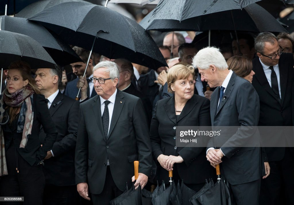 Former US President Bill Clinton, President of the EU Commission Jean-Claude Juncker and German Chancellor Angela Merkel pay respect to late former Chancellor Helmut Kohl during military honors after a mass on July 1, 2017 at the cathedral in Speyer. Germany. Kohl was chancellor of Germany for 16 years and led the country from the Cold War through to reunification. He died on June 16 at the age of 87.