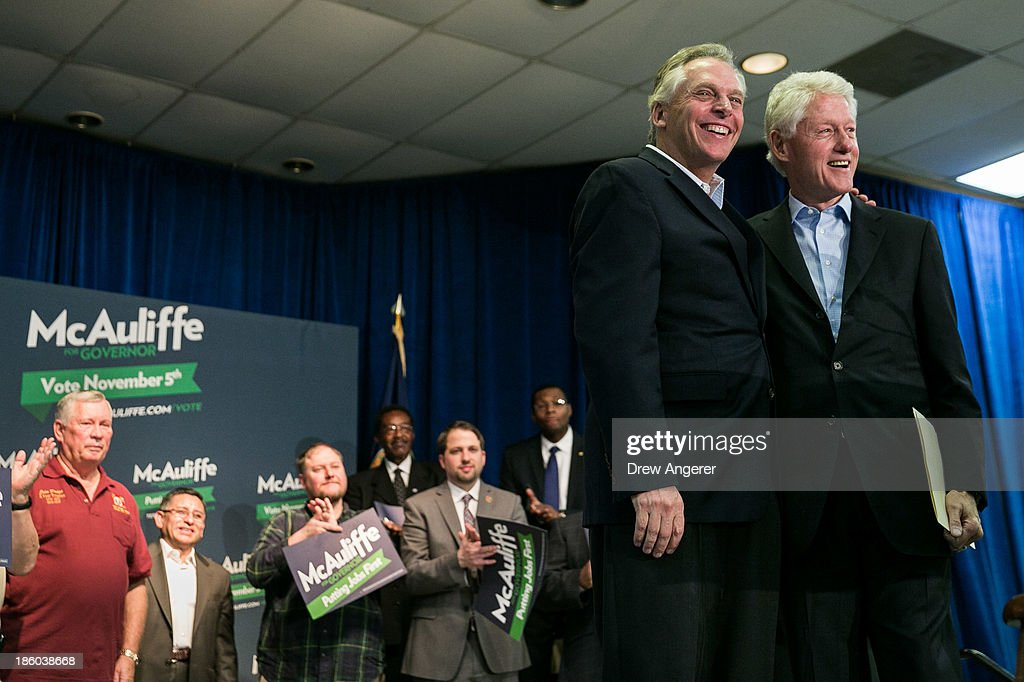 Former U.S. President Bill Clinton, R, and Virginia gubernatorial candidate Terry McAuliffe (D) smile toward the crowd during a campaign event for McAuliffe at VFW Post 1503, October 27, 2013 in Dale City, Virginia. McAuliffe is in a closely contested race with Republican candidate Ken Cuccinelli.