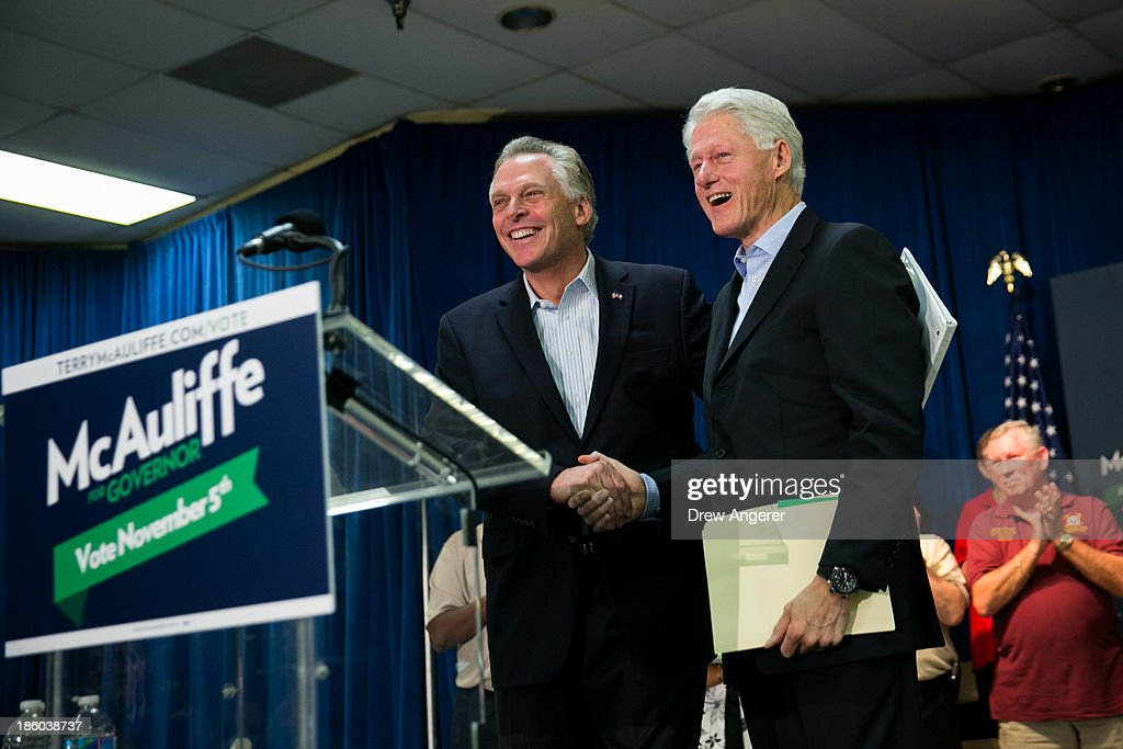Former U.S. President Bill Clinton, R, and Virginia gubernatorial candidate Terry McAuliffe (D) shake hands during a campaign event for McAuliffe at VFW Post 1503, October 27, 2013 in Dale City, Virginia. McAuliffe is in a closely contested race with Republican candidate Ken Cuccinelli.