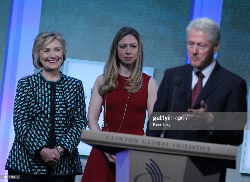 Former U.S. President <a gi-track='captionPersonalityLinkClicked' href=/galleries/search?phrase=Bill+Clinton&family=editorial&specificpeople=67203 ng-click='$event.stopPropagation()'>Bill Clinton</a>, right, speaks while <a gi-track='captionPersonalityLinkClicked' href=/galleries/search?phrase=Hillary+Clinton&family=editorial&specificpeople=76480 ng-click='$event.stopPropagation()'>Hillary Clinton</a>, former U.S. secretary of state, left, listens with daughter <a gi-track='captionPersonalityLinkClicked' href=/galleries/search?phrase=Chelsea+Clinton&family=editorial&specificpeople=119698 ng-click='$event.stopPropagation()'>Chelsea Clinton</a> during the annual meeting of the Clinton Global Initiative (CGI) in New York, U.S., on Tuesday, Sept. 24, 2013. CGI's 2013 theme, mobilizing for impact, explores ways that members and organizations can be more effective in leveraging individuals, partner organizations, and key resources in their commitment efforts. Photographer: Jin Lee/Bloomberg via Getty Images