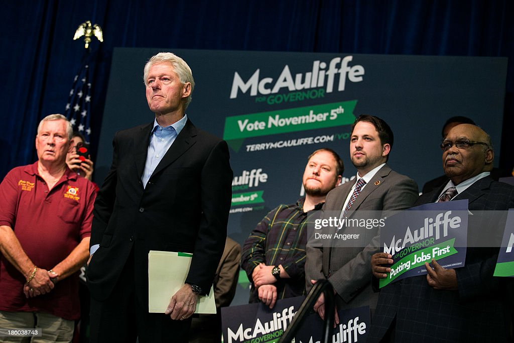 Former U.S. President Bill Clinton, second from L, listens to Virginia gubernatorial candidate Terry McAuliffe (D) during a campaign event for McAuliffe at VFW Post 1503, October 27, 2013 in Dale City, Virginia. McAuliffe is in a closely contested race with Republican candidate Ken Cuccinelli.