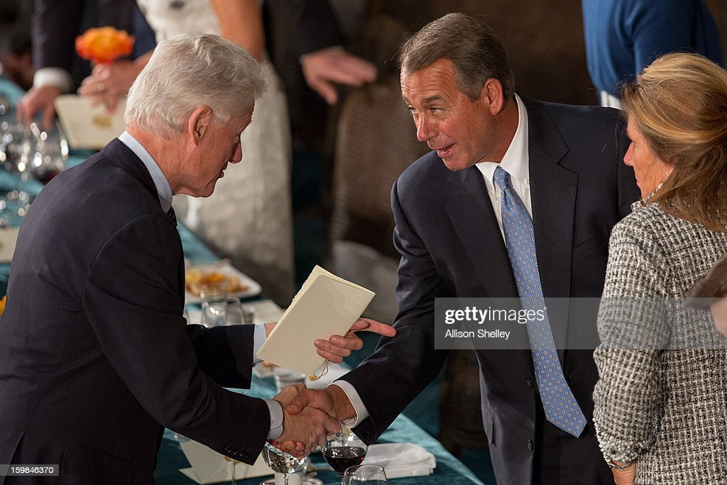 Former U.S. President <a gi-track='captionPersonalityLinkClicked' href=/galleries/search?phrase=Bill+Clinton&family=editorial&specificpeople=67203 ng-click='$event.stopPropagation()'>Bill Clinton</a> shakes hands with House Speaker John Boehner at the Inaugural Luncheon in Statuary Hall on Inauguration day at the U.S. Capitol building January 21, 2013 in Washington D.C. U.S. President Barack Obama was ceremonially sworn in for his second term today.