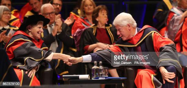 Former US president Bill Clinton shakes hands with Sister Stanislaus Kennedy aftwer they both received an honorary doctorates from Dublin City...