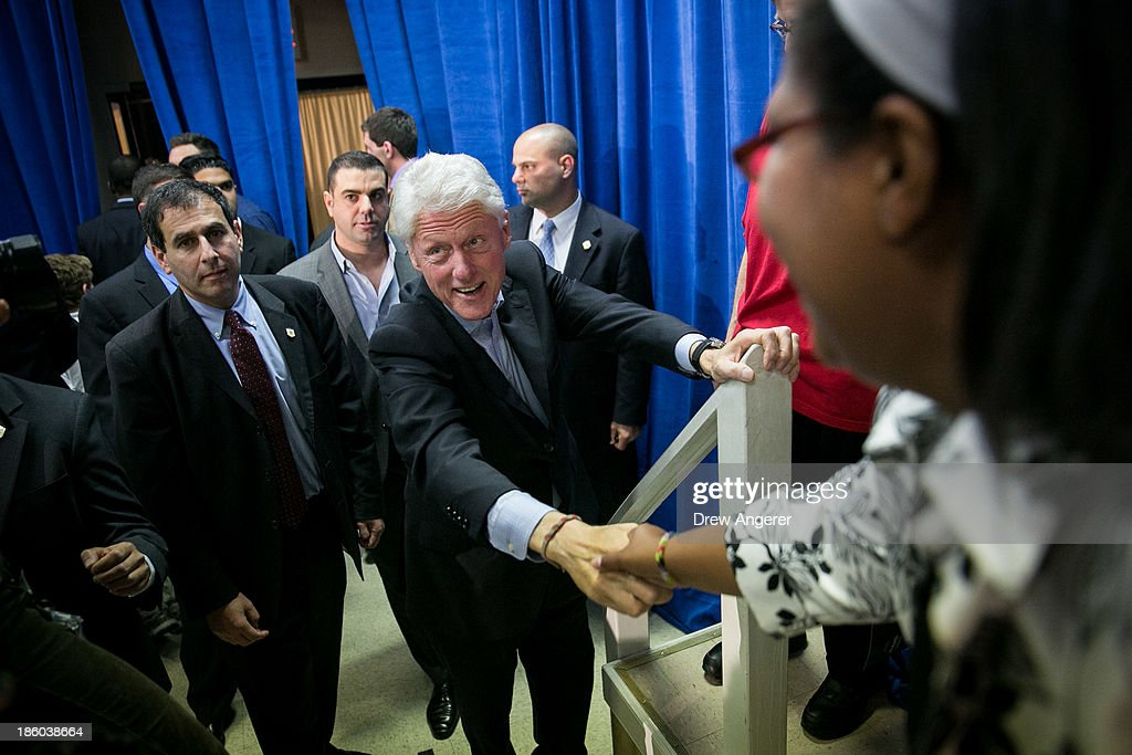 Former U.S. President Bill Clinton shakes hands with supporters at the end of a campaign event for Virginia gubernatorial candidate Terry McAuliffe (D) at VFW Post 1503, October 27, 2013 in Dale City, Virginia. McAuliffe is in a closely contested race with Republican candidate Ken Cuccinelli.