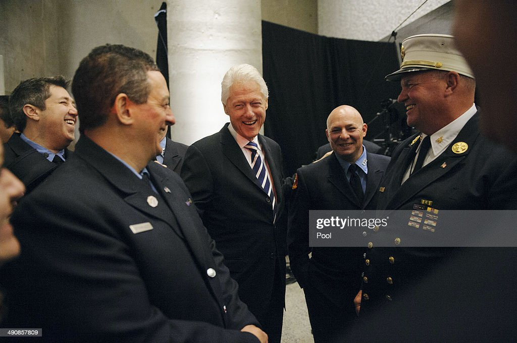 Former U.S. President <a gi-track='captionPersonalityLinkClicked' href=/galleries/search?phrase=Bill+Clinton&family=editorial&specificpeople=67203 ng-click='$event.stopPropagation()'>Bill Clinton</a> (C) shares a laugh with first responders at the end of the opening ceremony for the National September 11 Memorial Museum at ground zero May 15, 2014 in New York City. The museum spans seven stories, mostly underground, and contains artifacts from the attack on the World Trade Center Towers on September 11, 2001 that include the 80 ft high tridents, the so-called 'Ground Zero Cross,' the destroyed remains of Company 21's New York Fire Department Engine as well as smaller items such as letter that fell from a hijacked plane and posters of missing loved ones projected onto the wall of the museum. The museum will open to the public on May 21.